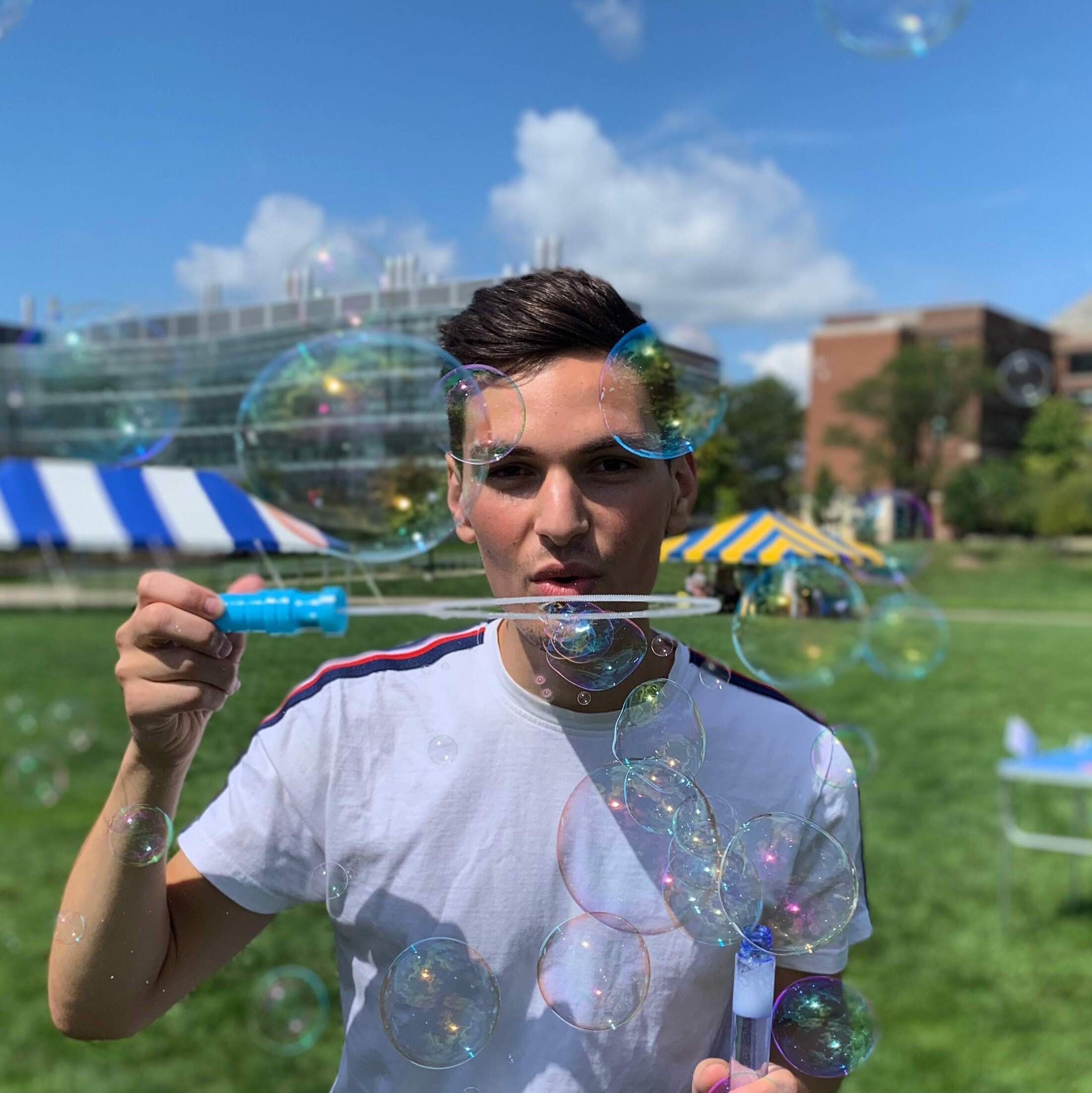 Picture of AJ Carter blowing bubbles
